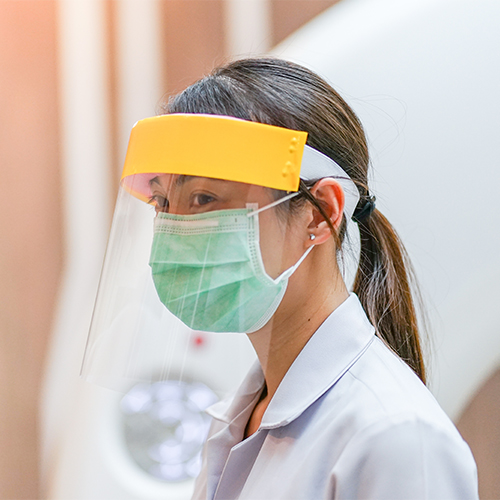 Person wearing a face shield